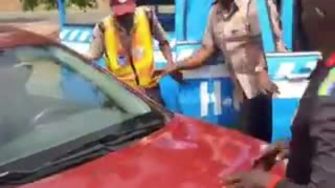Policeman spotted on bonnet of speeding vehicle of lady who refused to stop for security operatives