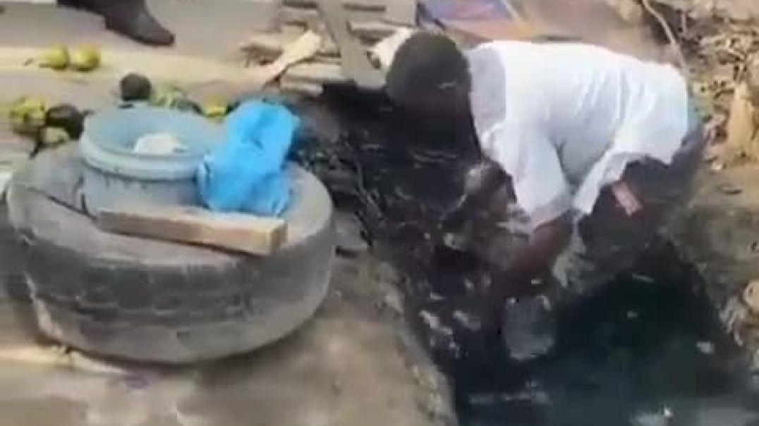 Be careful. Fruit seller caught  washing fruit in the gutter.  Part 2_
