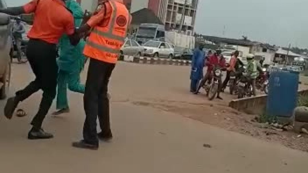 Nigerian police engaging in a boxing match with a civilian